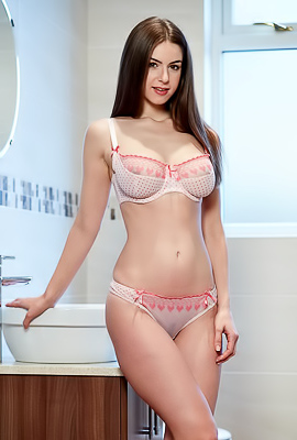 Busty Stella Cox removes her white lingerie in the bathroom