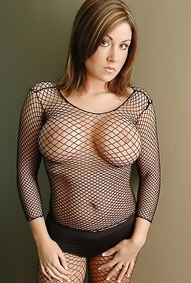 Hot and serious babe Krissy in sexy black fishnets